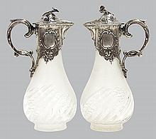 Pair of 19th century crystal and German .800 silver mounted ewers