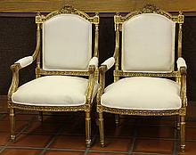 Pair of Louis XVI style giltwood carved fauteuils