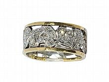 Diamond, platinum and 14k yellow gold eternity band