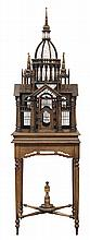 Victorian style architectural birdcage, circa 1940, with antique elements, of Cathedral form, having a center dome topped with a spi...