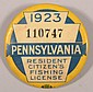 PA 1923 fishing license metal button- first year of pinback button. Condition: Good.