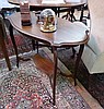 Edwardian mahogany two-tier occasional table, with