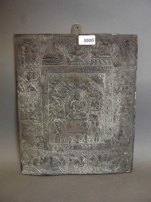 An antique Indian repousse copper panel, life of
