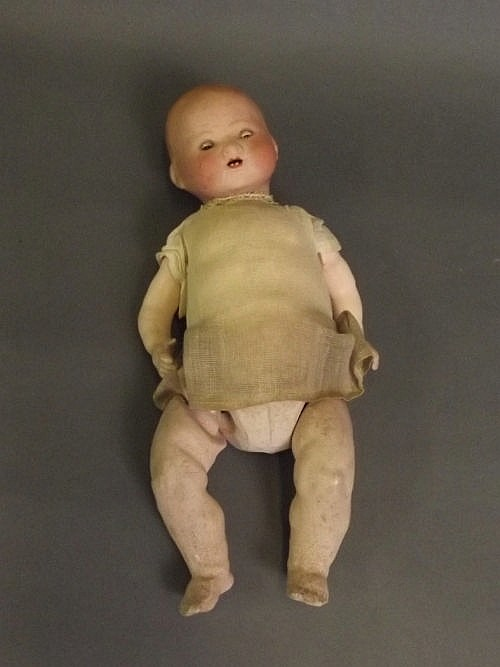 An Armand Marseille bisque headed toy doll with