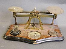 A set of postal scaled on a wooden base, 8½'' wide