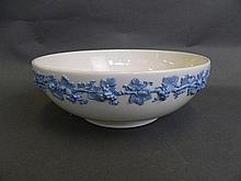 A Wedgwood bowl decorated with an applied fruiting