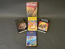 A collection of Harry Potter books, all hardbacks,