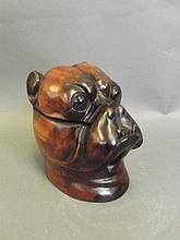 A Black Forest style carved wood inkwell in the