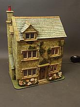 A doll's house with wired lighting and museum