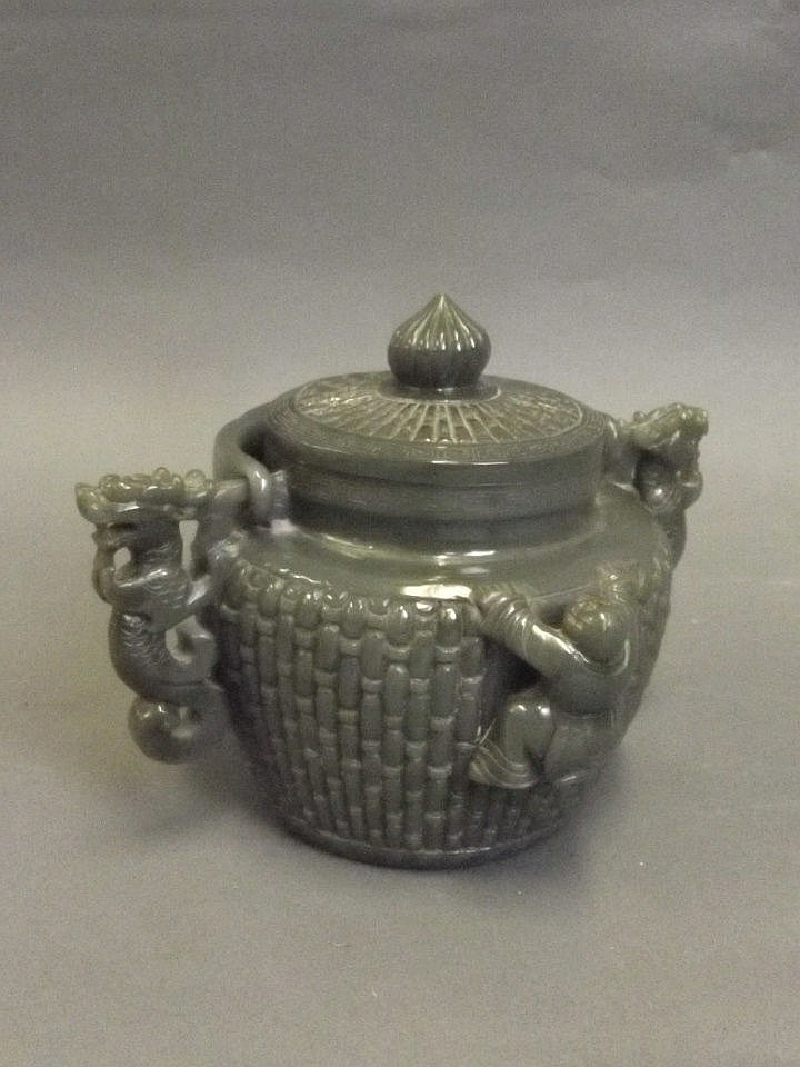 A Chinese spinach jade pot and cover with relief