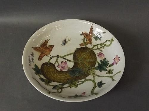 A Chinese porcelain dish with painted enamel