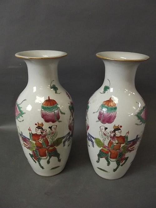 A pair of Chinese vases with applied enamel