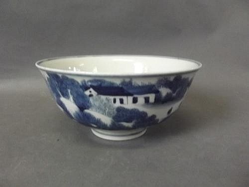 A Chinese blue and white bowl with rural scenes to