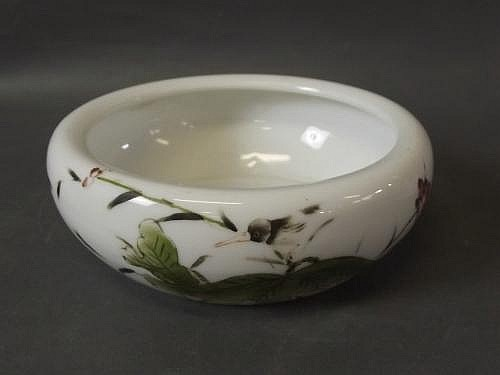 A Chinese shallow porcelain bowl with painted
