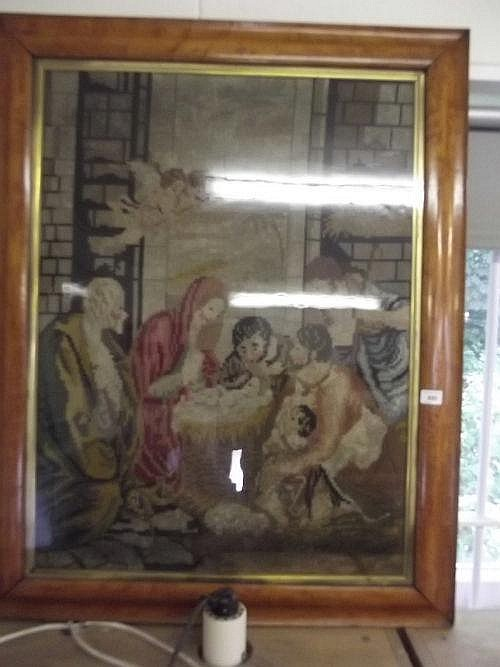 A large Victorian maple framed needlework picture,