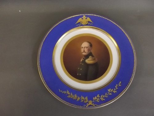 An Imperial Russian porcelain plate painted with a portrait of Nicholas I circa 1826-1855, within a blue and gilt boarder, underglazed 'NI' mark to base, 9¾