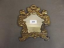 A 19th Century ornate brass wall mirror, 9