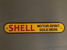 A cast iron advertising sign for Shell Motor