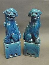 A pair of Chinese blue glazed pottery figures of