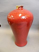 A large Chinese red glazed baluster shaped vase,