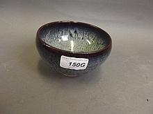 A Chinese flambe glazed pottery bowl, 5