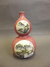 A Chinese porcelain pink ground double gourd