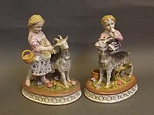 A pair of Continental porcelain figures of a boy