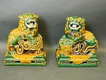 A pair of green and yellow glazed Chinese figures