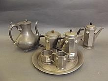 An Art Deco hammered pewter five piece tea set