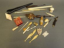A quantity of carved ebony, bone and ivory sewing