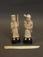A pair of Chinese carved ivory figures on wood