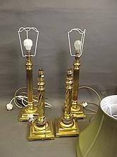 A pair of brass corinthian column table lamps, and