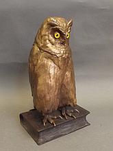 A large cold painted bronze figure of an owl stood