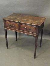 An 18th Century oak two drawer side table with