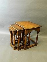 A nest of three solid oak occasional tables, 20
