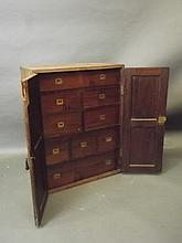 A 19th Century teak four door cupboard fitted with