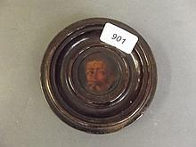An 18th Century circular miniature painting of a