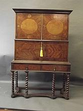 An Edwardian walnut and mahogany escritoire in the