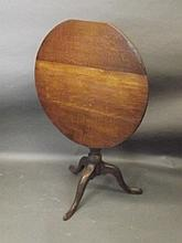 A 19th Century oak tilt top occasional table, 28½