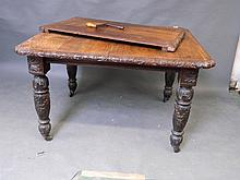 A Victorian carved oak extending dining table with