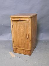An Art Deco walnut pot cupboard with slide, 13½