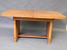 A good quality Art Deco oak extending dining table