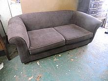 A contemporary upholstered sofa, 76