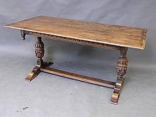 A solid oak refectory dining table on carved