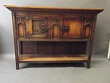 A good quality gothic carved oak Bruges cupboard