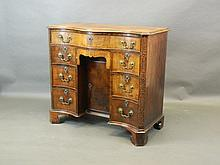 An 18th Century serpentine fronted kneehole desk