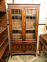 An Edwardian oak two door leaded light bookcase