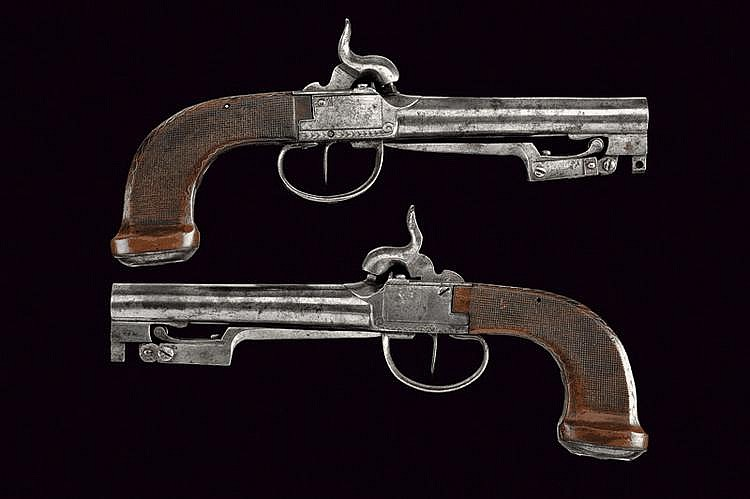 A pair of percussion traveling pistols with spring bayonet