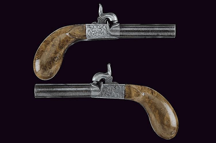 A pair of double-barrelled percussion pistols