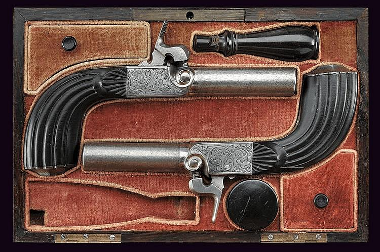 A pair of percussion cased pocket pistols